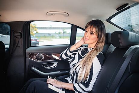 Passenger inside a luxury car